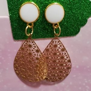 White stud earrings with gold filigree charms